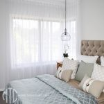 White s-fold sheer curtains on a corner window