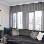 Charcoal s-fold sheer curtains on black rods