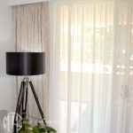 Beige trellis pattern blockout curtains with ivory sheer curtains
