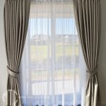 Silver blockout curtains with tiebacks & white sheer on silver rods