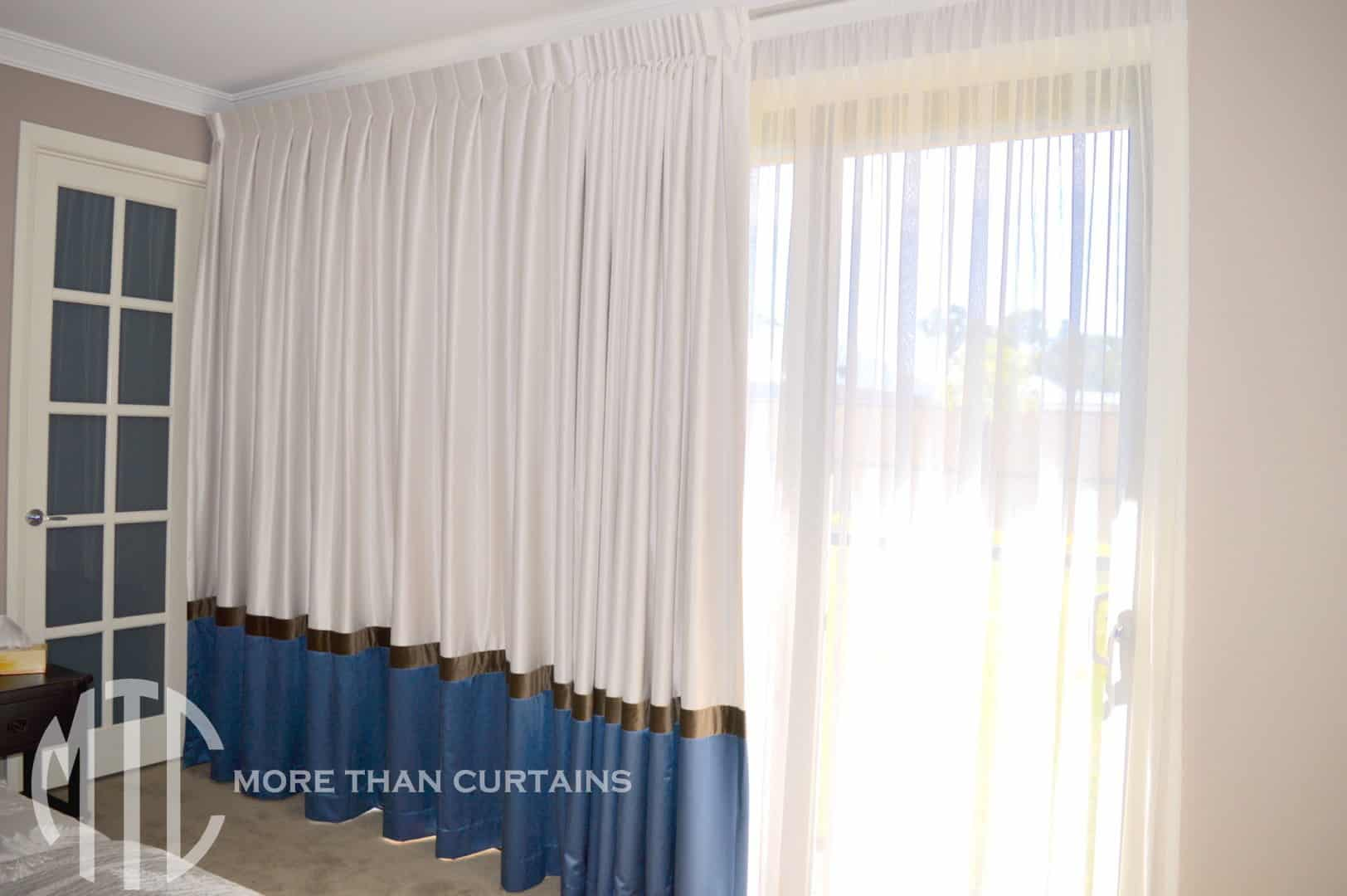 Ivory box pleat curtains with brown contrast band & navy blue hem & ivory sheer
