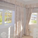 Beige leaf pattern curtains with matching box pleat valance & coordinating Roman blinds