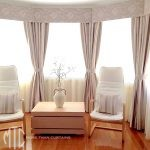 Blockout & sheer curtains with pelmetson a bay window with tiebacks