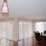 Patterned sheer curtains with pelmets