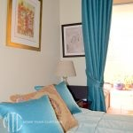 teal curtains, pelmet & cushion with aqua bedspread - Mosman