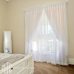 White goblet pleat sheer curtains with seperate lining on a painted timber rod