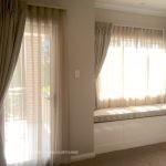 Beige sheer & blockout pinch pleat curtains with trellis design window seat