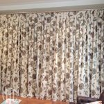 Batik floral box pleat curtain on a painted timber rod