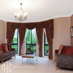 Curtains with swags & tails on a bay window