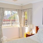 Curtains, pelmets & roller blinds on a corner window