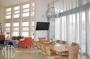 two storey s-fold sheer curtains on a curved window - Bella Vista