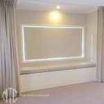 Beige pinch pleat sheer curtains, blockout roller blind & trellis design window seat