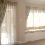 Beige sheer & blockout pinch pleat curtains with trellis design window seat