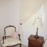 Plantation shutters with a sheer curtain