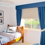 Blue blockout curtains with matching pelmet, beige tiebacks & blockout roller blind