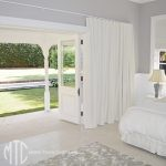 White s-Fold blockout curtains with matching Roman blind