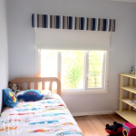 White roller blind with blue & beige striped pelmet