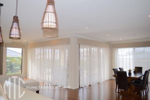 Sheer curtains under pelmets