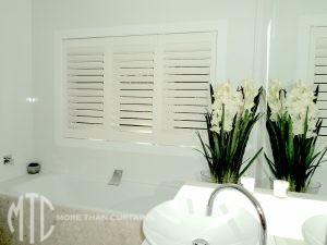 Aluminium shutters in bathroom