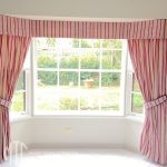box pleat valance and side drapes on a bay window