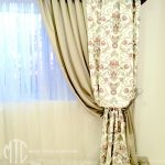 White sheer, gold blockout & embroidered damask curtains with gold shaped pelmets