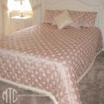 Diamond quilted bedspread with cushions