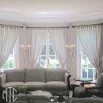 Double thickness sheer curtains on hand painted rods