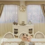 Shaped pelmets and bishops sleeved curtains