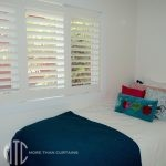 Painted hardwood plantation shutters