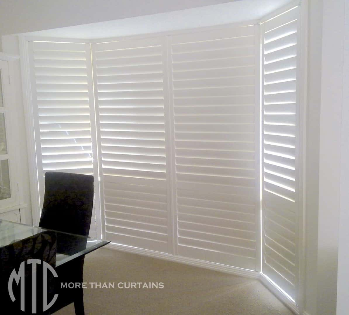 Plantation Shutters On A Floor To Ceiling Bay Window