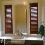 Stained timber plantation shutters