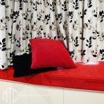 Red window seat walled cushion, cushions & silver patterned curtain - Glenorie