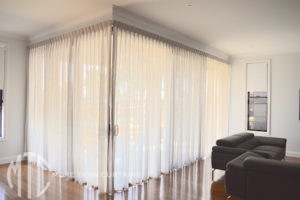 Box Pleat Sheer curtains on corner window - Schofields