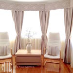Dusty rose patterned curtains, pelmets & tiebacks with ivory sheers on a bay window
