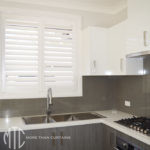 Painted hardwood plantation shutters in kitchen window