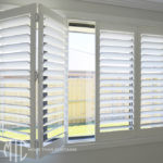 Bifold painted hardwood plantation shutters - North Richmond