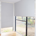 Grey blockout roller blinds