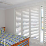 Painted hardwood plantation shutters kid's room