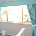 aqua pelmets and drapes with white piping & white tiebacks
