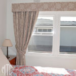 Pelmet with blockout curtains & tiebacks