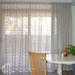 Trellis patterned sheer s-fold curtain