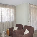 Patterned sheer s-fold curtain
