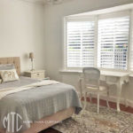 Painted hardwood plantation shutters in a bay window
