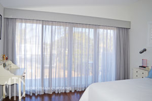 Pelmet with contrast piping & sheer curtains