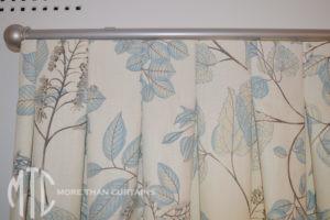 Patterned Box Pleat curtains on a metal rod - Killara