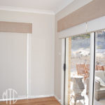 Ivory roller blinds with beige velvet pelmet