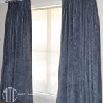 Charcoal velvet triple pinch pleat curtains on a silver hand painted timber rod