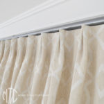 Euro pleat curtain heading on a metal rod