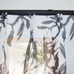 Black & White leaf patterned double pinch pleat sheer curtains on black rods
