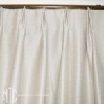 Euro pleat curtain on metal rod